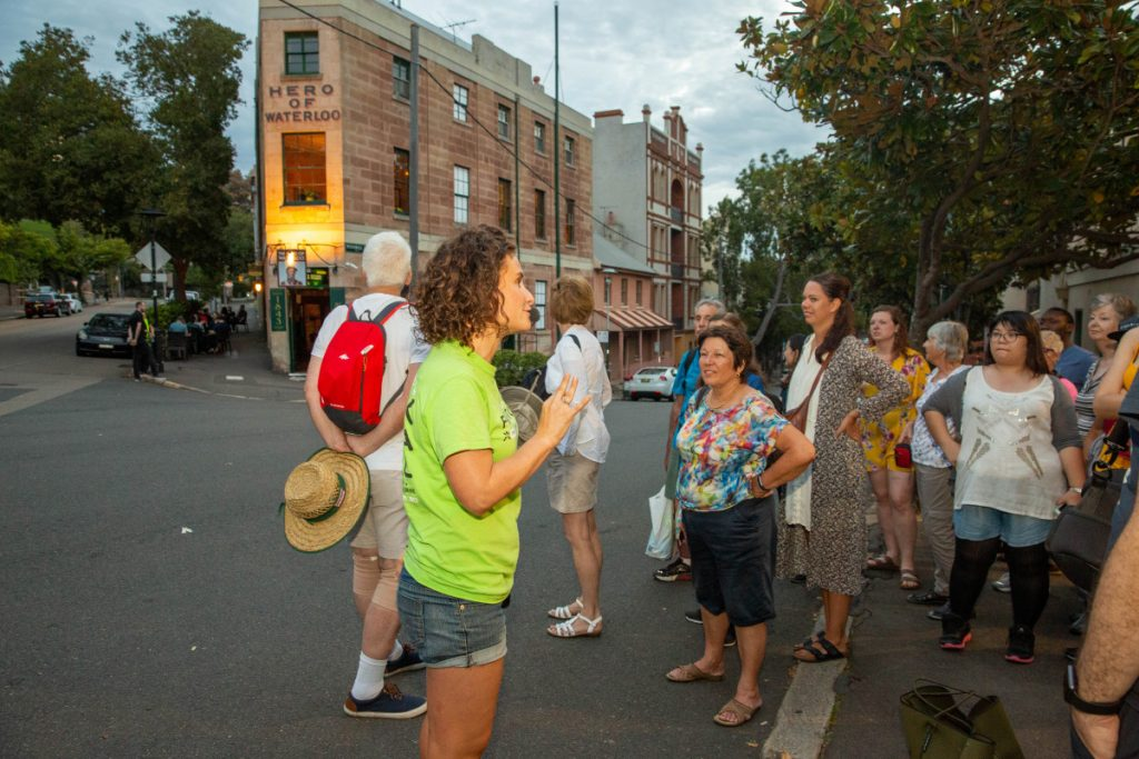 Group of tourists attending an I'm Free tour of The Rocks district